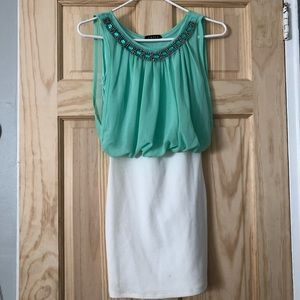 Cute light teal shirt and white skirt (connected).